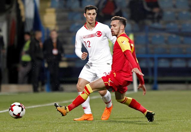 Soccer Football - International Friendly - Montenegro vs Turkey - Podgorica City Stadium, Podgorica, Montenegro - March 27, 2018 Turkey's Kaan Ayhan in action with Montenergo's Marko Vesovic REUTERS/Stevo Vasiljevic