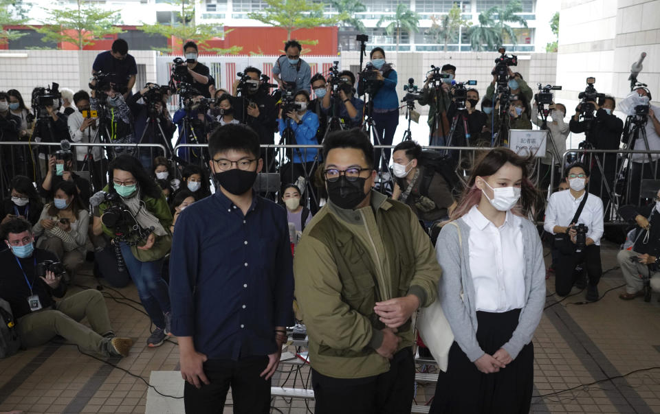 Hong Kong activists, from left, Joshua Wong, Ivan Lam and Agnes Chow arrive at a court in Hong Kong, Monday, Nov. 22. 2020. The trio appears at court for their trial as they face charges related to the besieging of a police station during anti-government protests last year. (AP Photo/Vincent Yu)