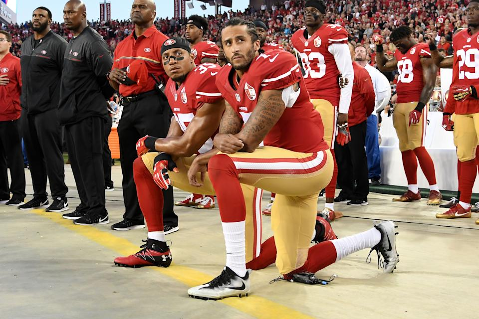 Colin Kaepernick #7 and Eric Reid #35 of the San Francisco 49ers kneel in protest during the national anthem prior to playing the Los Angeles Rams in their NFL game at Levi's Stadium on September 12, 2016 in Santa Clara, California. (Thearon W. Henderson/Getty Images)