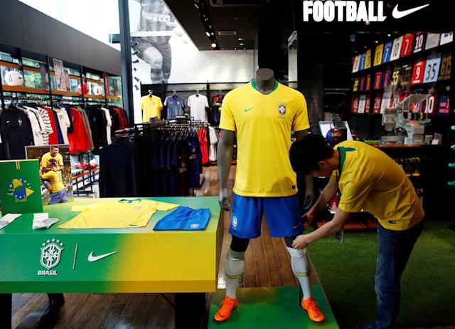 A clerk checks the display of Brazil's national soccer team's uniform at soccer shop KAMO in Tokyo, Japan May 17, 2018. REUTERS/Kim Kyung-Hoon