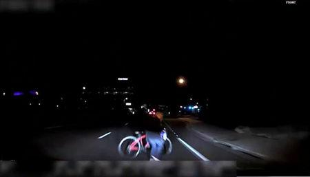 A handout photo of a still frame taken from video shows the exterior view of the self-driving Uber vehicle leading up to the fatal collision in Tempe, Arizona