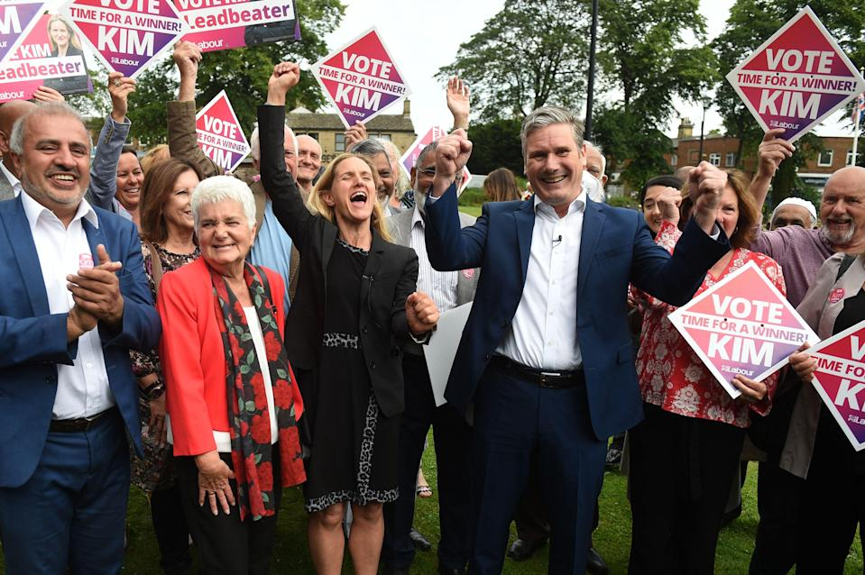 Keir Starmer and Labour candidate Kim Leadbeater celebrate with supporters in Cleckheaton Memorial Park during a visit following Labour's victory in the Batley and Spen by-election, in Cleckheaton, West Yorkshire on July 2 (AFP/Getty)