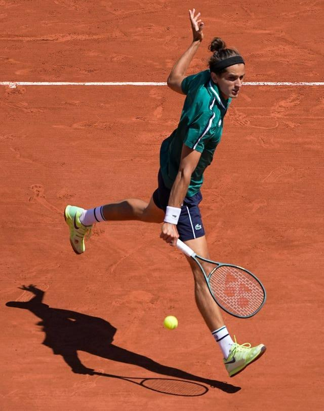 Pierre-Hugues Herbert of France leaps into a backhand during his five-set loss to Jannik Sinner