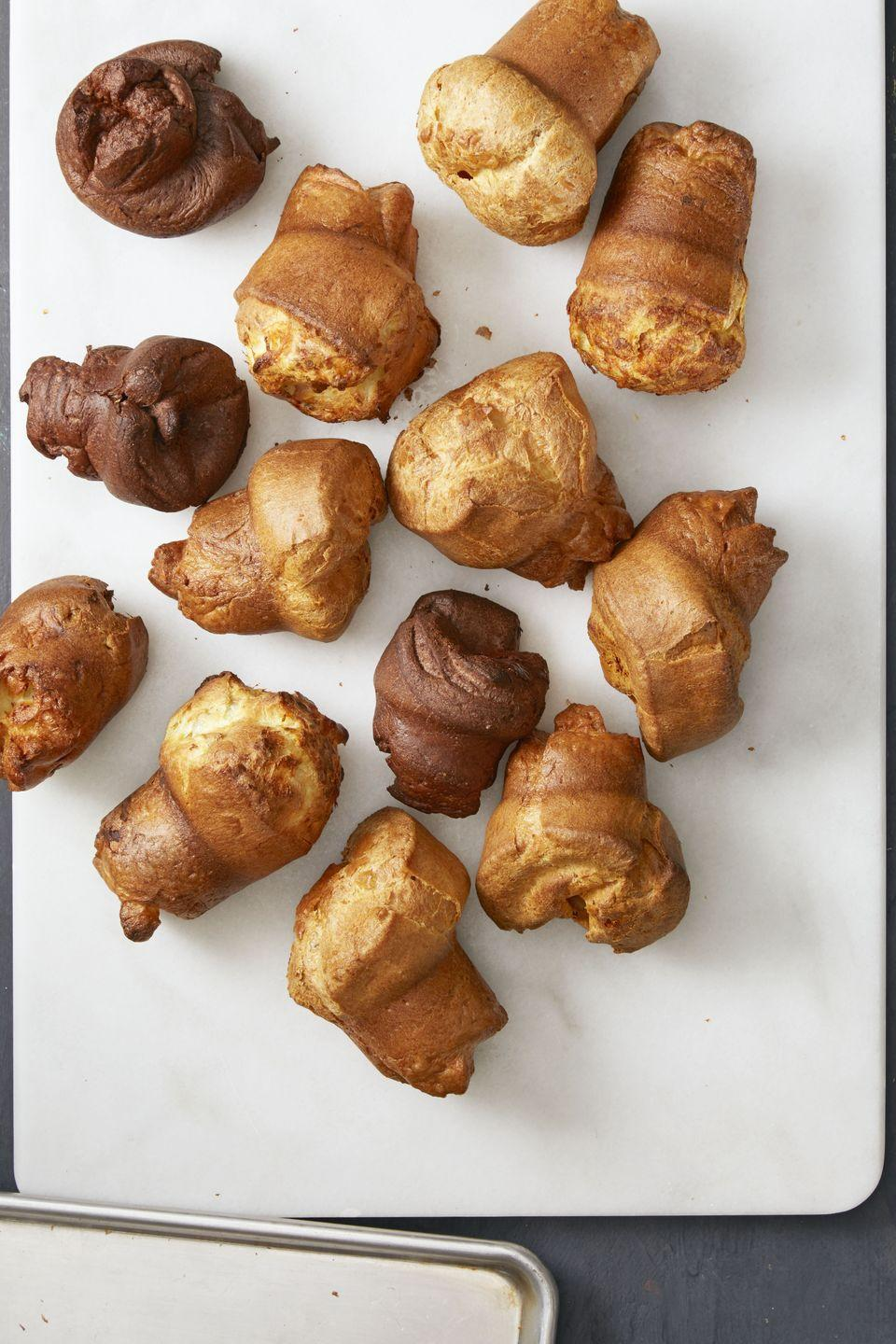 "<p>These guys are light, airy and porky. Basically everything we want in a breakfast pastry.</p><p><em><em><a href=""https://www.goodhousekeeping.com/food-recipes/easy/a35298/bacon-cheese-popovers/"" rel=""nofollow noopener"" target=""_blank"" data-ylk=""slk:Get the recipe for Bacon Cheese Popovers »"" class=""link rapid-noclick-resp"">Get the recipe for Bacon Cheese Popovers »</a></em></em></p>"