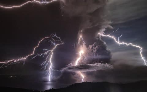 <span>The lightning is caused by volcanic ash sparking static electricity </span> <span>Credit: Ezra Acayan/Getty </span>