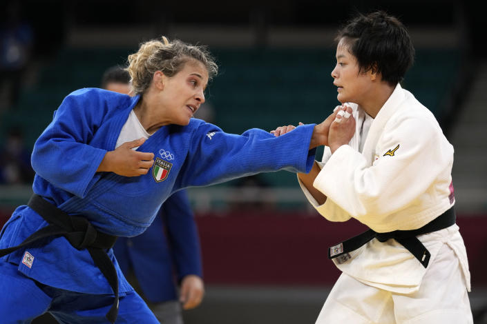 Odette Giuffrida of Italy, left, and Uta Abe of Japan compete during their women's -52kg semifinal judo match at the 2020 Summer Olympics, Sunday, July 25, 2021, in Tokyo, Japan. (AP Photo/Vincent Thian)