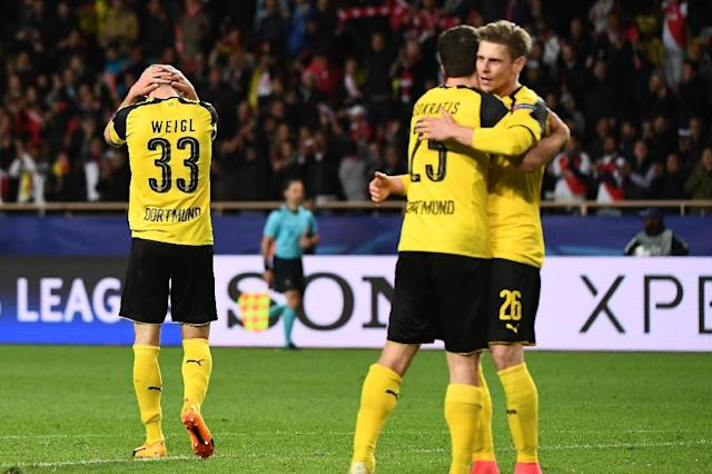 Dortmund's players react after losing against Monaco in their UEFA Champions League 2nd leg quarter-final football match on April 19, 2017 at the Louis II stadium in Monaco (AFP Photo/BORIS HORVAT)