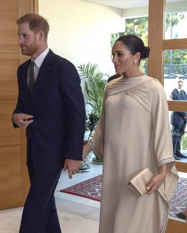 Meghan Markle Looks Radiant In Cape Dress As She And