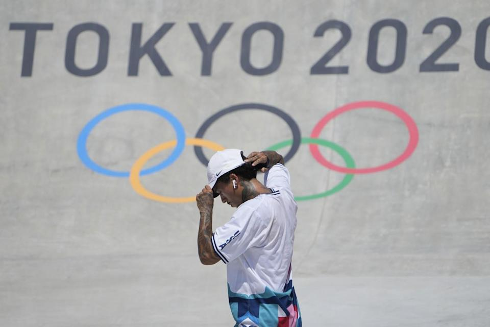 Nyjah Huston picks himself up after failing to complete a trick in the Olympic street skateboarding competition Sunday.