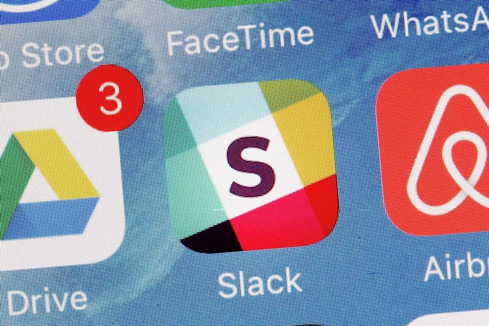 """The Slack app is displayed on a mobile phone, Tuesday, Jan. 31, 2017, in New York. Slack Technologies is hoping to convert more big businesses to its online business messaging service by making it easier for workers in different departments to communicate with each other. The new option, called """"Enterprise Grid,"""" represents another major step in Slack's attempt to get more workers and employers to lessen their dependence on conventional email and embrace its service instead. (AP Photo/Mark Lennihan)"""