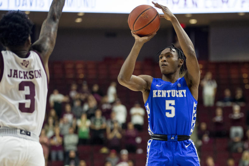 Kentucky guard Immanuel Quickley (5) shoots a 3-point basket as Texas A&M guard Quenton Jackson (3) defends during the first half of an NCAA college basketball game Tuesday, Feb. 25, 2020, in College Station, Texas. (AP Photo/Sam Craft)