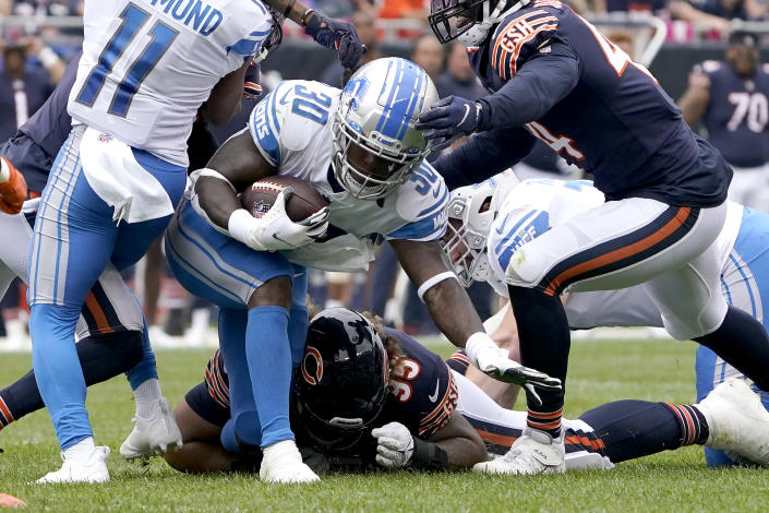 Detroit Lions running back Jamaal Williams carries the ball during the first half of an NFL football game against the Chicago Bears Sunday, Oct. 3, 2021, in Chicago. (AP Photo/David Banks)