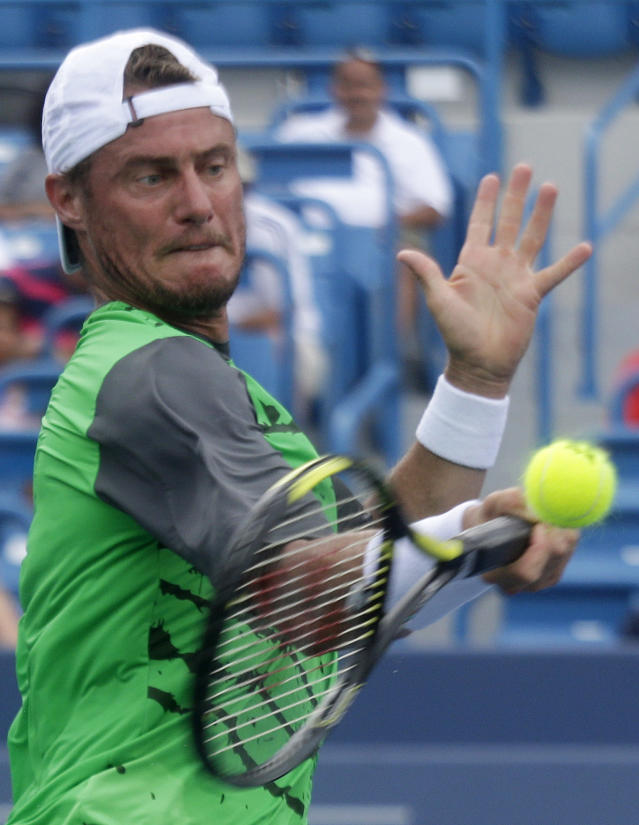 Lleyton Hewitt, from Australia, hits a forehand during a first-round match against Jurgen Melzer, from Austria, at the Western & Southern Open tennis tournament, Sunday, Aug. 10, 2014, in Mason, Ohio. (AP Photo/Al Behrman)