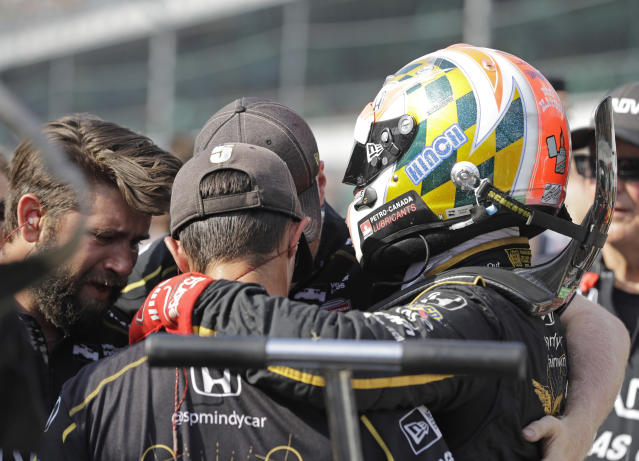 James Hinchcliffe, of Canada, consoles the crew after they did not qualifying for the IndyCar Indianapolis 500 auto race at Indianapolis Motor Speedway in Indianapolis, Saturday, May 19, 2018. (AP Photo/Darron Cummings)