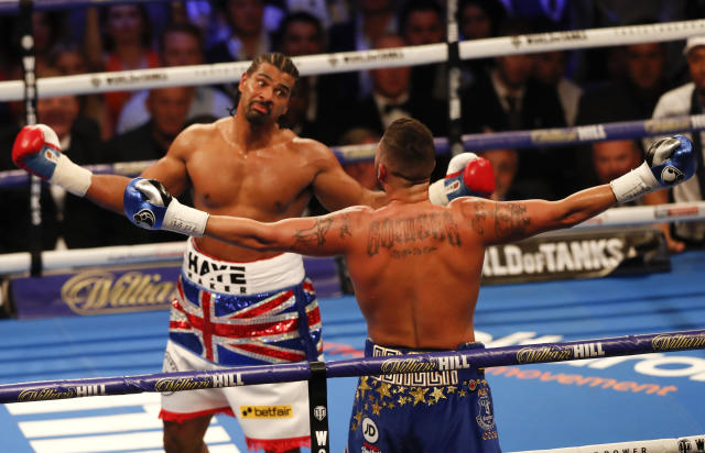 Tony Bellew, right, and David Haye during the boxing heavyweight rematch bout between Tony Bellew and David Haye at the O2 Arena in London, Saturday, May 5, 2018. (AP Photo/Frank Augstein)