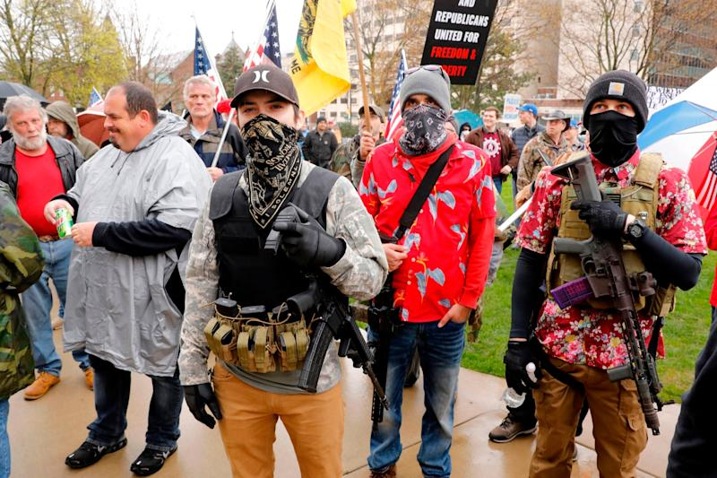 Armed protesters take part in a demonstration at the state Capitol in Lansing, Michigan against lockdown measures during the coronavirus pandemic: AFP via Getty Images