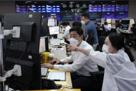 Currency traders work at the foreign exchange dealing room of the KEB Hana Bank headquarters in Seoul, South Korea, Thursday, Sept. 23, 2021. Asian shares were mostly higher on Thursday after the Federal Reserve signaled it may begin easing its extraordinary support measures for the economy later this year. (AP Photo/Ahn Young-joon)