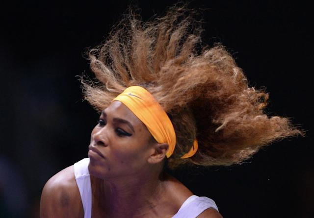 Serena Williams of the US returns a shot to Li Na of China during their final tennis match at the WTA Championship in Istanbul, Turkey, Sunday, Oct. 27, 2013. The world's top female tennis players compete in the championships which runs from Oct. 22 until Oct. 27.(AP Photo)