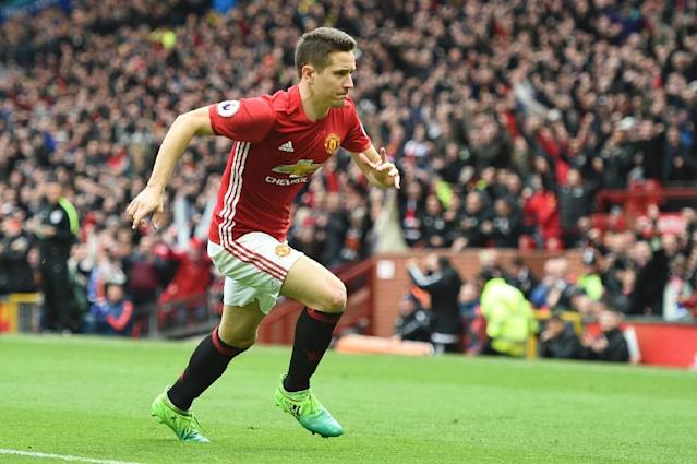 Manchester United's midfielder Ander Herrera runs to the corner to celebrate scoring their second goal during the English Premier League football match between Manchester United and Chelsea on April 16, 2017 (AFP Photo/Oli SCARFF )