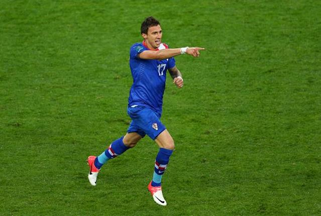 POZNAN, POLAND - JUNE 10: Mario Mandzukic of Croatia celebrates scoring their first goal during the UEFA EURO 2012 group C between Ireland and Croatia at The Municipal Stadium on June 10, 2012 in Poznan, Poland. (Photo by Clive Mason/Getty Images)