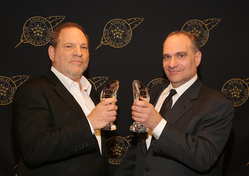 Harvey and Bob Weinstein pose with the Motion Picture Showmanship Award backstage at The Beverly Hilton hotel on Feb. 20, 2015. (Mathew Imaging via Getty Images)