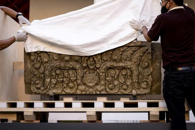 The two ancient sandstone lintels, a sacred late 10th or 11th century sandstone support beam, were returned to Thailand after decades in the United States