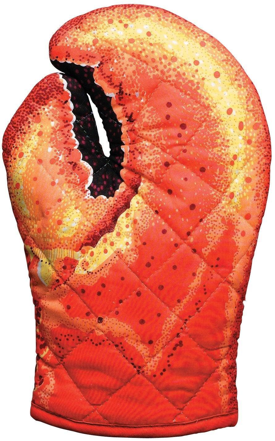 """In other kitchen-related White Elephant gifts, this highly-rated oven mitt is the perfect affordable present for the aspiring chef who loves to cook with <a href=""""https://www.youtube.com/watch?v=JzYMi5wSc7g"""" rel=""""nofollow noopener"""" target=""""_blank"""" data-ylk=""""slk:big, meaty claws"""" class=""""link rapid-noclick-resp"""">big, meaty claws</a>.<br><br><strong>Boston Warehouse</strong> Lobster Claw Oven Mitt, Quilted Cotton, $, available at <a href=""""https://amzn.to/2P9Wbt2"""" rel=""""nofollow noopener"""" target=""""_blank"""" data-ylk=""""slk:Amazon"""" class=""""link rapid-noclick-resp"""">Amazon</a>"""