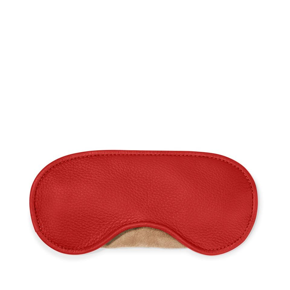 """""""I sleep on almost every flight, and a big part of that is my eye mask. It blocks out all the light and sends a message to people to leave me alone. Literally. Leatherology lets you customize your eye mask, and mine says """"BYEEEEE'.""""  <strong>Buy It! </strong>Leatherology eye mask, $25 (before monogramming); <a href=""""https://shareasale.com/r.cfm?b=945342&u=1772040&m=68975&urllink=https%3A%2F%2Fwww.leatherology.com%2Feyemask&afftrack=PEO%2CNinaDobrev%27sTravelMust-Haves%2Caapatoff%2CUnc%2CGal%2C7451684%2C201911%2CI"""" target=""""_blank"""" rel=""""nofollow"""">leatherology.com</a>"""