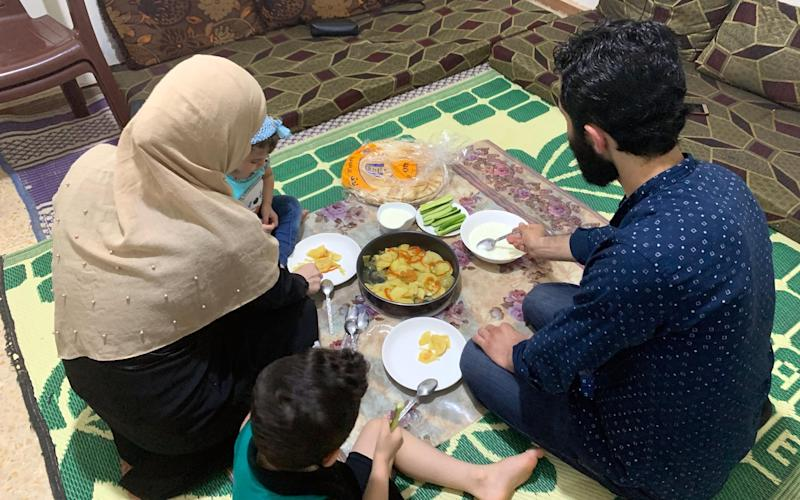 Thirty-year-old Mohamad and his wife Asma sit down to a meagre meal with their children - Abbie Cheeseman