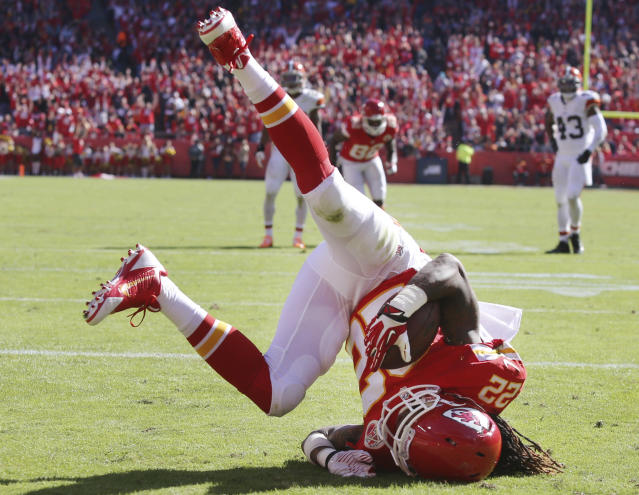 Kansas City Chiefs wide receiver Dexter McCluster (22) lands in the end zone for a touchdown after a catch during the first half of an NFL football game against the Cleveland Browns in Kansas City, Mo., Sunday, Oct. 27, 2013. (AP Photo/Ed Zurga)