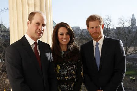 Britain's Prince William, Kate Duchess of Cambridge and Prince Harry pose for p hotograph at the Institute of Contemporary Arts in central London, Britain January 17, 2017. REUTERS/Stefan Wermuth