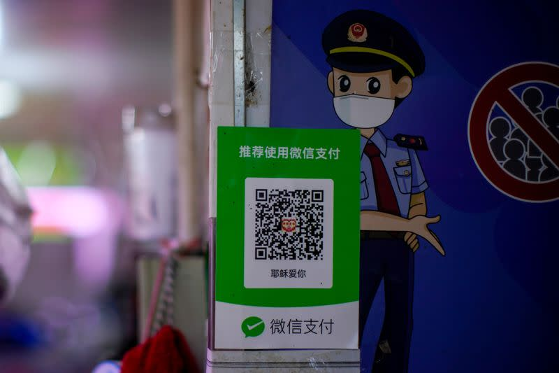 A QR code of the digital payment service WeChat Pay is seen at a shop, in Shanghai