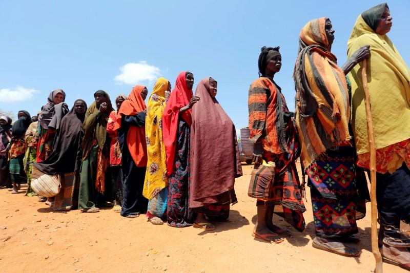 FILE PHOTO: Internally displaced Somali women queue for relief food at a distribution centre organized by a Qatar charity after fleeing from drought stricken regions in Baidoa, west of Somalia's capital Mogadishu
