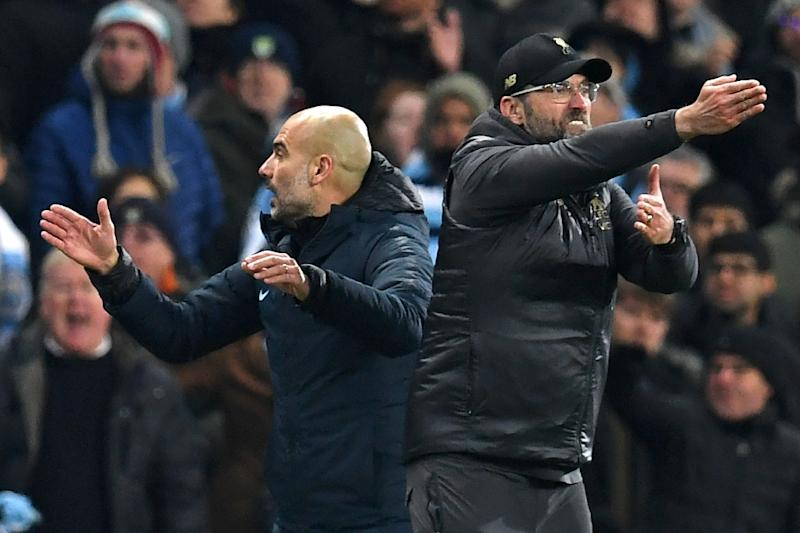 Liverpool manager Jurgen Klopp (right) and Manchester City boss Pep Guardiola are going head to head for the Premier League title (AFP Photo/Paul ELLIS)