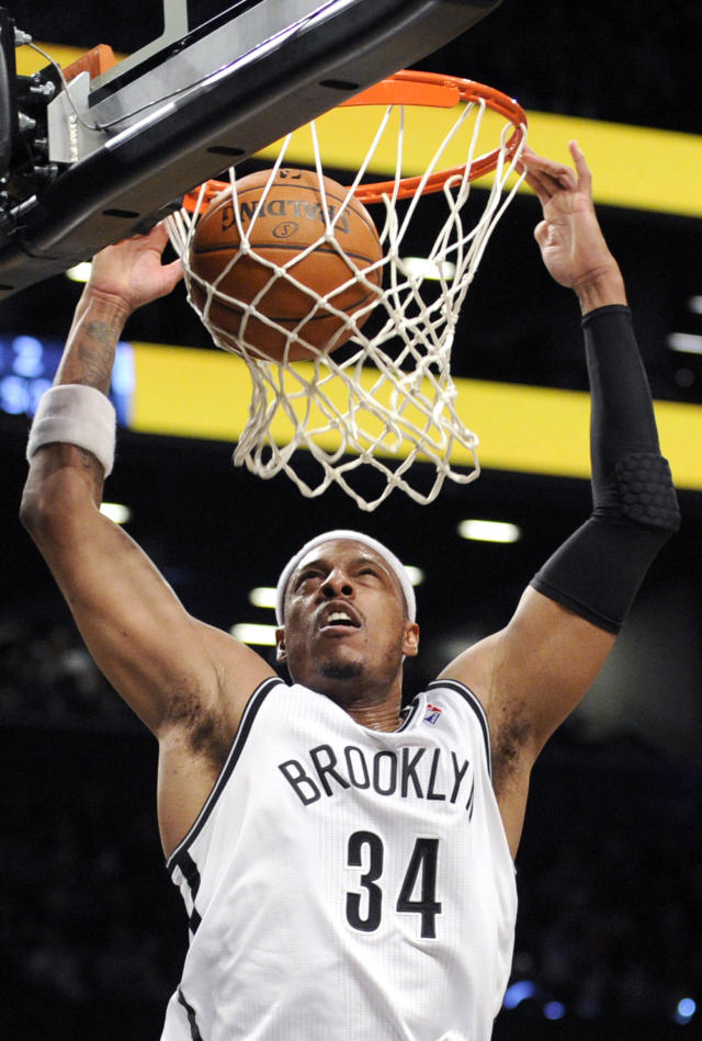 Brooklyn Nets' Paul Pierce dunks the ball during the first quarter of an NBA basketball game against the Minnesota Timberwolves Sunday, March 30, 2014, at Barclay's Center in New York. (AP Photo/Bill Kostroun)