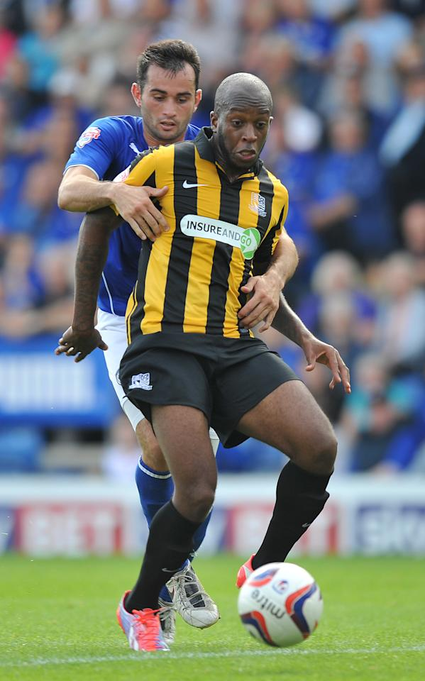 Southend United's Anthony Straker is held back by Chesterfield's Sam Hird during the Sky Bet Football League Two match at the Proact Stadium, Chesterfield.