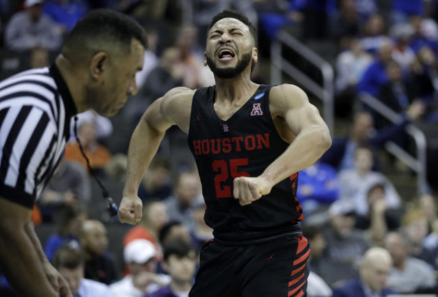Houston's Galen Robinson Jr. lets out a yell during the second half of a men's NCAA tournament college basketball Midwest Regional semifinal game against Kentucky, Friday, March 29, 2019, in Kansas City, Mo. (AP Photo/Charlie Riedel)