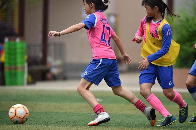 You do not have to scratch far below the surface to see that women's football in China is struggling for recognition (AFP Photo/HECTOR RETAMAL)