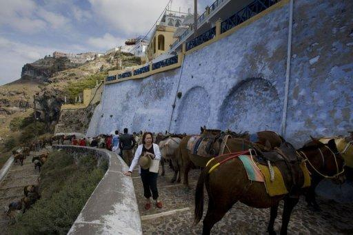 Tourists at the island of Santorini in 2008. Nearly 180,000 foreign nationals flew into Santorini last year, up 10.5 percent, and about 80 percent of all visitors are non-Greek, many of them honeymoon travellers and retired couples