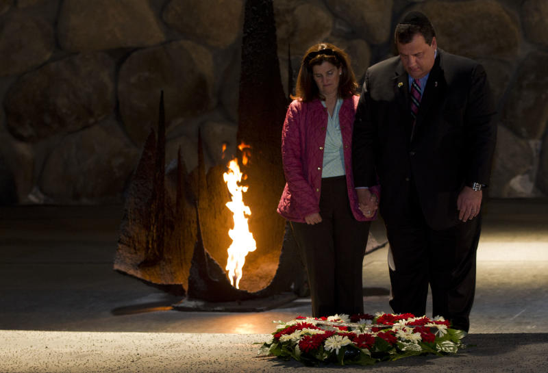 New Jersey Gov. Chris Christie and his wife Mary Pat pause after laying a wreath at the Hall of Remembrance at the Yad Vashem Holocaust memorial in Jerusalem, Tuesday, April 3, 2012. Christie kicked off his first official overseas trip Monday meeting Israel's leader in a visit that may boost the rising Republican star's foreign policy credentials ahead of November's presidential election. (AP Photo/Bernat Armangue)