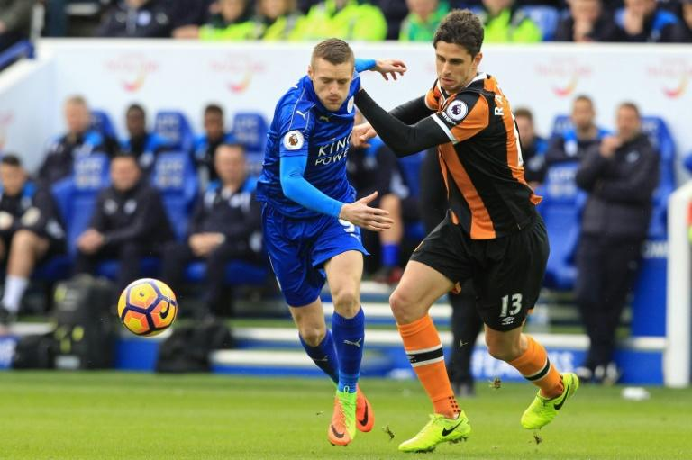 Leicester City's striker Jamie Vardy (L) vies with Hull City's defender Andrea Ranocchia during the English Premier League football match March 4, 2017