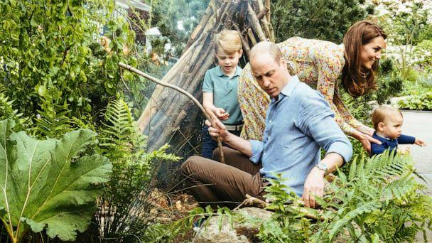 PHOTO:Prince William, Kate, Duchess of Cambridge and their children, Prince George, Princess Charlotte and Prince Louis play in the Adam White and Andree Davies co-designed garden in London in this photo released on May 19, 2019. (Matt Porteous/Kensington Palace via AP)