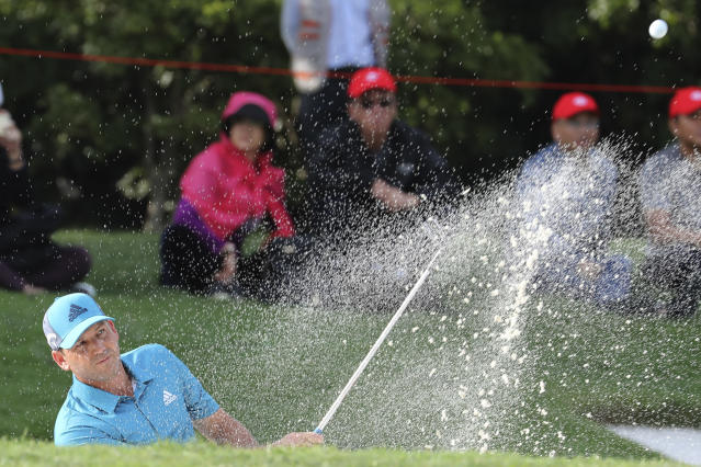 Sergio Garcia of Spain hits the ball from a bunker during the HSBC Champions golf tournament held at the Sheshan International Golf Club in Shanghai on Friday, Nov. 1, 2019. (AP Photo/Ng Han Guan)