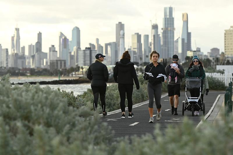 Melburnians exercise along Elwood Beach on July 13.