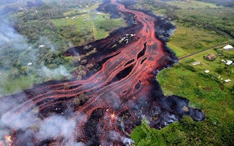 """Authorities were racing on Tuesday to close off production wells at a geothermal plant threatened by a lava flow from Kilauea volcano onHawaii's Big Island. Workers were capping the 11th and last well at the plant to prevent toxic gases from wafting out after lava entered, then stalled, on the property near one of the new volcanic vents. """"Right now, they're in a safe state,"""" Mike Kaleikini, senior director ofHawaiiaffairs for the Puna Geothermal Venture plant, said of the wells. There also were plans to install metal plugs in the wells as an additional stopgap measure. The wells run as far as 8,000 feetunderground at the plant, which covers around 40 acres of the 815-acre property. The plant has capacity to produce 38 megawatts of electricity, providing roughly one-quarter of the Big Island's daily energy demand. Lava destroyed a warehouse adjacent tothe planton Monday, bringing the total number of structures destroyed in the past several weeks to nearly 50, including dozens of homes.  Puna Geothermal, owned by Nevada's Ormat Technologies, was shut down shortly after Kilauea began spewing lava on May 3. The plant harnesses heat and steam from the earth's core to spin turbines to generate power. A flammable gas called pentane is used as part of the process, though officials earlier this month removed 50,000 gallons of the gas from the plant to reduce the chance of explosions. NativeHawaiians have long expressed frustration with the plant since it came online in 1989; they believe it is built on sacred land. Goddess of fire, Pele, is believed to live on Kilauea volcano, and the plant itself is thought to desecrate her name. Other residents have voiced concerns over health and safety. Scientists, however, say the conditions on Kilauea make it a good site for harnessing the earth for renewable energy. """"There's heat beneath the ground if you dig deep enough everywhere,"""" said Laura Wisland, a senior analyst at the Union of Concerned Scientists. But in some places in the U"""
