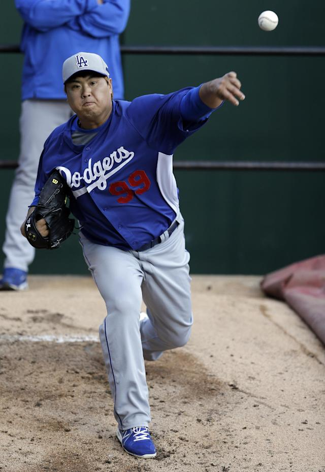Los Angeles Dodgers pitcher Hyun-Jin Ryu, of South Korea, throws in the bullpen during practice for the National League baseball championship series Thursday, Oct. 10, 2013, in St. Louis. The Dodgers are scheduled to play the St. Louis Cardinals in Game 1 of the NLCS on Friday in St. Louis. (AP Photo/Jeff Roberson)