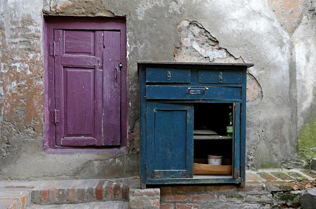 <p>A small door and a piece of furniture are seen on a street in the old town, Tbilisi, Georgia, April 6, 2017. (Photo: David Mdzinarishvili/Reuters) </p>