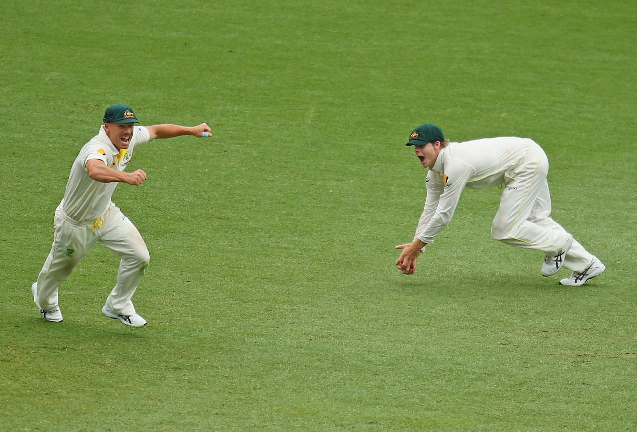 BRISBANE, AUSTRALIA - NOVEMBER 24:  Steven Smith of Australia takes a catch in the slips to remove Graeme Swann of England during day four of the First Ashes Test match between Australia and England at The Gabba on November 24, 2013 in Brisbane, Australia.  (Photo by Scott Barbour/Getty Images)