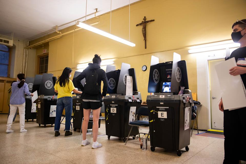 Voters scan completed ballots at the Church of St. Anthony of Padua polling site during the New York City mayoral primary election on June 22.