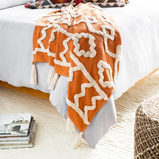 """If a colorful boho throw is more their style, this tasseled orange number will do the trick. $119, Jungalow. <a href=""""https://www.jungalow.com/collections/throw-blankets/products/tangerine-throw-blanket"""" rel=""""nofollow noopener"""" target=""""_blank"""" data-ylk=""""slk:Get it now!"""" class=""""link rapid-noclick-resp"""">Get it now!</a>"""